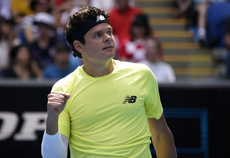Milos Raonic celebrates with a win over Croatia's Marin Cilic in the fourth round of Australian Open