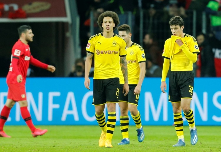 Borussia Dortmund players look upset after failing to beat Bayer Leverkusen in Bundesliga