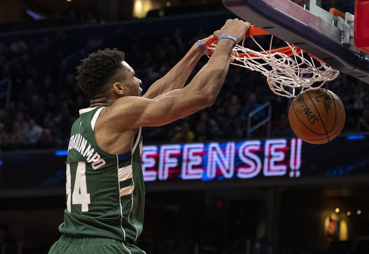Milwaukee Bucks forward Giannis Antetokounmpo dunks the ball during an NBA clash against the Wizards