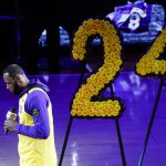 Lakers star LeBron James wears a Kobe Bryant jersey as he gives a speech during the tribute to the basketball legend