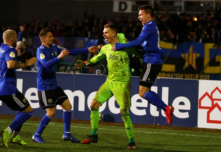FC Saarbrucken keeper Daniel Batz celebrates after his side reached the next phase of DFB-Pokal