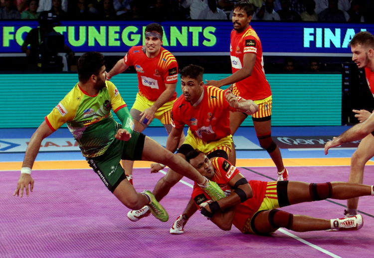 Raider Pardeep Narwal of Patna Pirates goes for a raid in a Pro Kabaddi League match