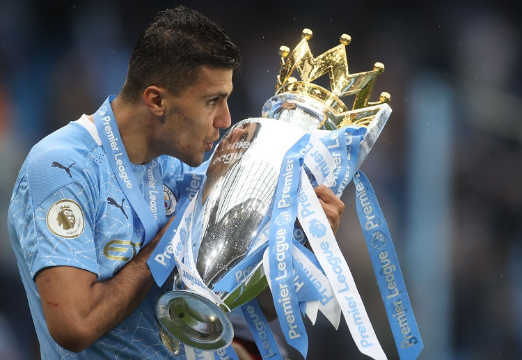 Manchester City's Rodrigo celebrates with the trophy after winning the Premier League