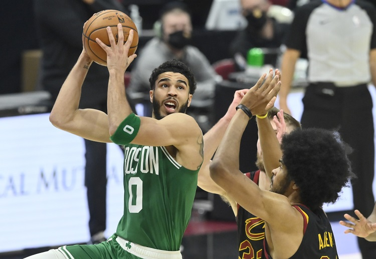 Celtics forward Jayson Tatum holding the ball during the NBA match with the Cavaliers