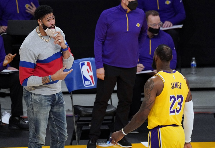 LeBron James speaks to Anthony Davis after the NBA match